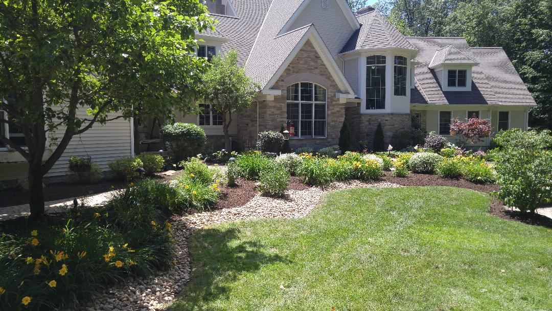New mulch being laid in landscape bed at The Chagrin Valley home.